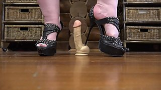 Thin heels trample rubber dick with eggs. Crush fetish and ballbusting