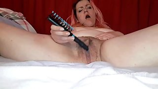 inebriated mommy puts hairbrush in her fat pussy