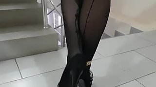 Walking milf outdoors with high heels