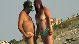 Girl touches Cock in public beach while looking a stranger - XVOYEURSEX